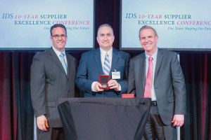 David Pearson, President of LCR, at center accepting award from John Bergeron (left) and Mike Shaughnessy (right) of Raytheon